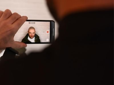 Taking a photo of Scalp micropigmentation client